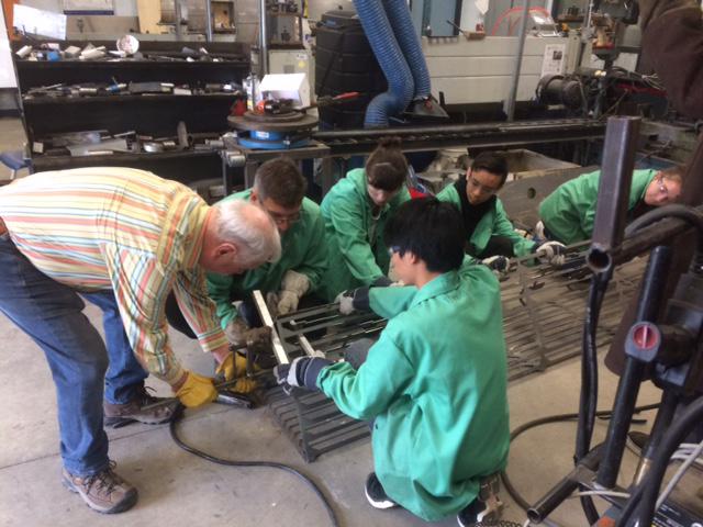 Artist Ron Baird mentors Our Lady of Lourdes students welding metal sculpture