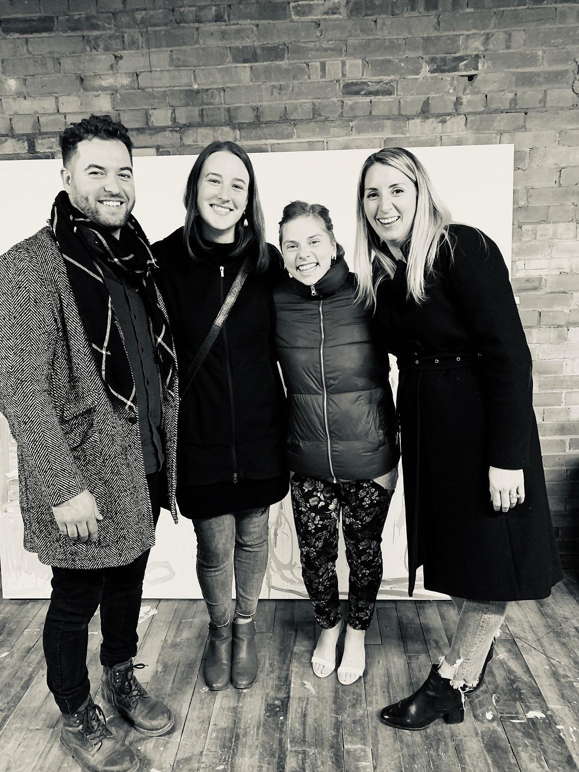 Gifting of KIAM studio to Abby and Ahmri. From left to right Kiel WIlson Ciocci Ahmri Vanderborne Abby Nowakowski Amanda Copy