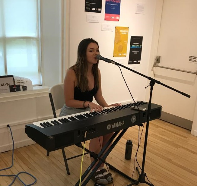 Singer songwriter and GEAMP participant Mikalyn Hay performing at the opening reception of Treading Loudly. Photo credit Shawn Chen RBC web