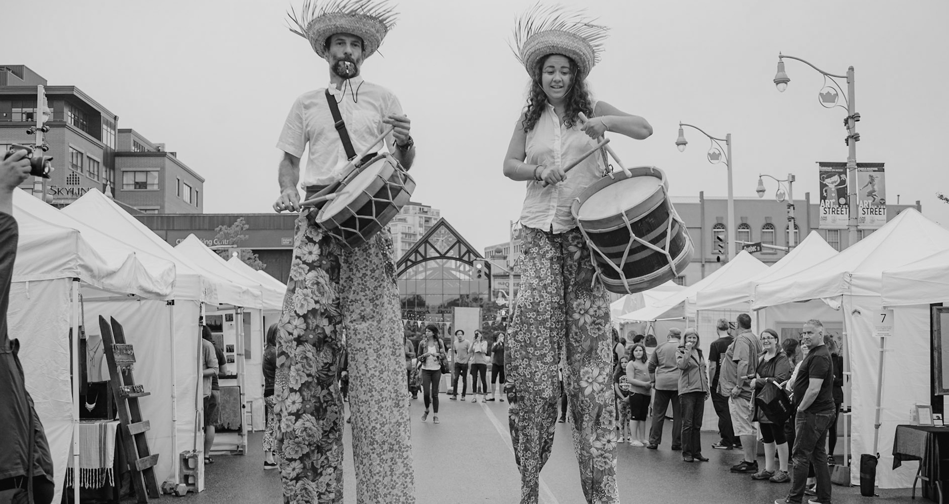 performers playing drums on stilts